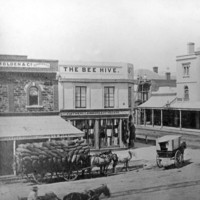 Image: Corner store with horse carriages