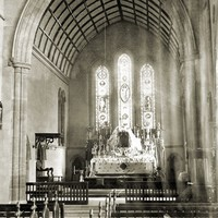 Image: View of church interior, including altar and stained glass windows
