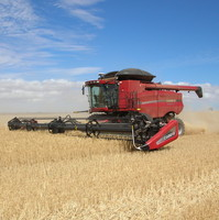 Image: A harvester in the process of harvesting a crop