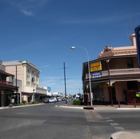 Image: A view down a main street of the town Kadina showing a pub to the rights, and other various buildings