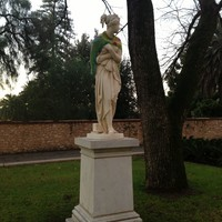Image: statue with crocehted cape around shoulders