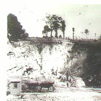 Image: Photo of a quarry with horse and carts and workmen