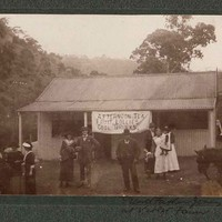 Image: group of people standing in front of building