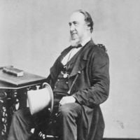 Image: Black and white photograph of older man on a chair, circa 1860