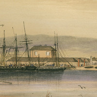 Image: A colour lithograph of the Port Adelaide waterfront during the early nineteenth century. A group of men and women are embarking aboard a row boat, and a three-masted ship rides at anchor in the harbour. Other ships are moored at a wharf