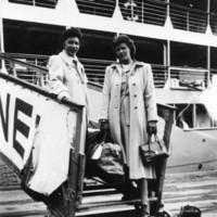 Image: Two women disembarking from a ship