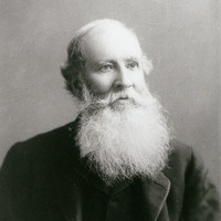 Image: Portrait of a man with a white beard and dark jacket