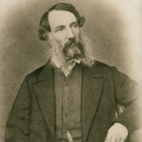 Image: Black and white photograph of a seated man in mid nineteenth century attire.