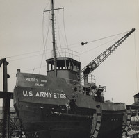 Image: Front view of a tug boat sitting in a yard in the process of being constructed