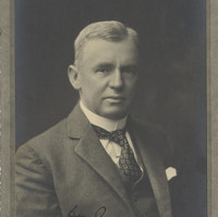Image: portrait of man wearing tie and suit jacket