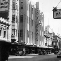 Image: Large department store in Art Deco style dwarfing the adjacent cinema