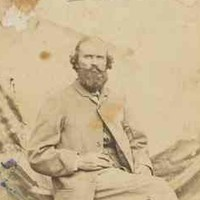 Bearded man seated in chair