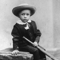 Image: Small boy with cricket bat
