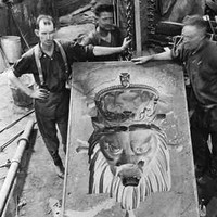 Image: men with stone monument in progress