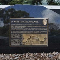 Close-up of plaque on East side of West Terrace