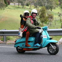 Image: two people on a motor scooter