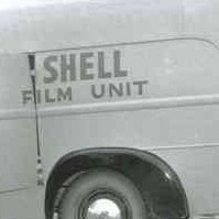 Image: A man in 1950s attire loads equipment into a panel van. The words 'Shell Film Unit' are painted on the side and back of the van