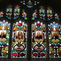 Scientific window, featuring portraits of eminent scientists, Watt, Newton, Stephenson, Bessamer, Brookman Building, 2013
