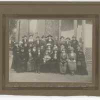 Image: A black and white photograph containing an image of Deborah Moulden amongst her committee members for the S.S. & Nurses' Relatives Association.