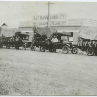 Image: Black and white photograph of three trucks outside Alf Hannaford & Co store