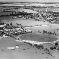 Image: flooded landscape with oval outlined by floodwaters
