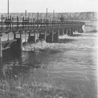 Image: Man standing on bridge over river