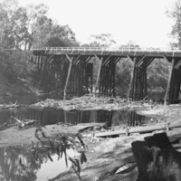Image: bridge with river underneath it and irrigation works