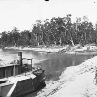 Image: Boat on land next to river Murray
