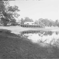 Image: buildings on edge of river, intended for boat landing purposes