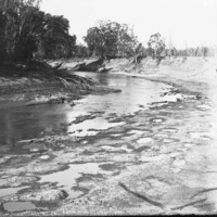 Image: View of river with trees along river bank