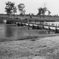 Image: Man on bridge over the river
