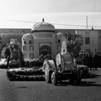 Image: floral floats in front of building