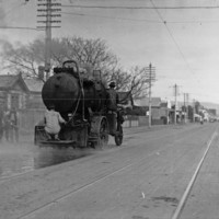Image: Black and white photo of a Mann tar-sprayer on Unley Road, twentieth century.