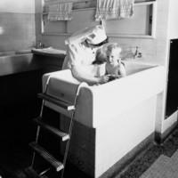 Image: Nurse bathing boy