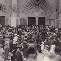 Image: People gathered within a chapel as a funeral takes place