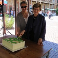 Image: two women cutting cake