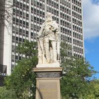 Image: stone statue of man on stone pillar