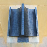 Image: metal sundial in two curved halves