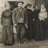 Image: group of people, old woman on right holding young baby in arms