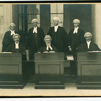 Image: Seven bewigged and robed supreme court judges, seated and posing for photograph, 1915