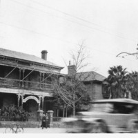Image: Black and white photograph showing the exterior of the original Liberal Union Club located in a double story Victorian style house on North Terrace