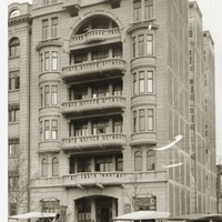 Image: Black and white photograph showing the Liberal Club building as it appeared in 1927. It shows the building old cars with canopy style roofs sitting out the front.