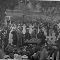 Various officials and members of public mill about whilst the BCLB and Navy Band perform standing amongst them