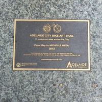 Plaque set in stone and the foot of the sculpture