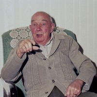 Image: caucasian man sitting in an armchair tells a story