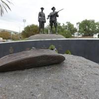 Image: bronze sculpture of curved wooden vessel