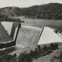 Image: Black and white photograph of dam and reservoir, before completion, circa 1938