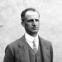 Image: A photographic portrait of a man wearing a suit with waistcoat