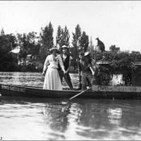 Image: Two people posing in a row boat