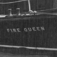 Image: A small motor launch with water cannons and the name 'Fire Queen' emblazoned on its bow sits stationary in a river